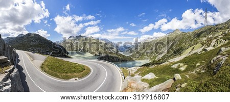 pass Grimselpass with lake Grimselsee in the Swiss mountains - stock photo