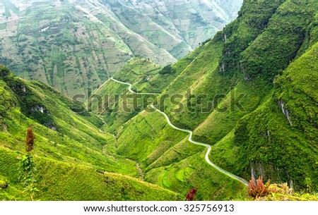 Pass road hugs the mountain plateau of Dong Van, Ha Giang, Vietnam is very treacherous, but the most beautiful, peaceful. The more I see love their country more - stock photo