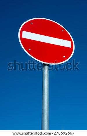 passage forbidden traffic sign in front of blue sky - stock photo