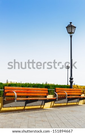 Passage in Spanish town with lamp posts - stock photo