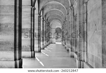 Passage leading towards archway at colonnade - stock photo