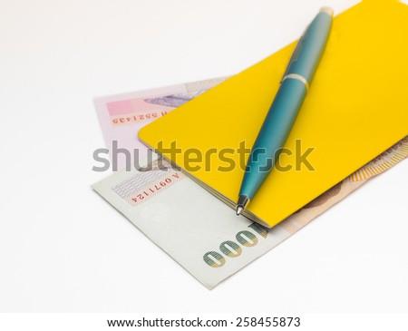 passbook and Thai money on white background - stock photo