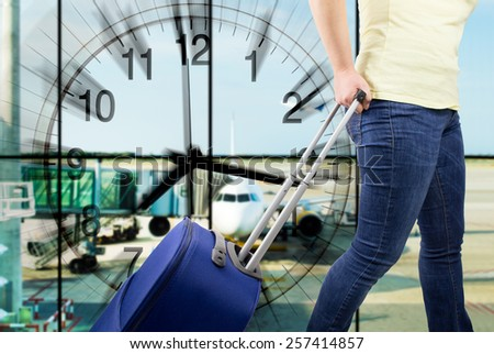 passenger accessing the gate with a clock indicating the time - stock photo