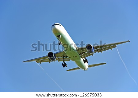 Passenger aircraft arriving to the airport - stock photo