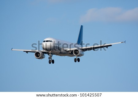 Passenger airplane coming in for a landing - stock photo