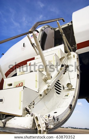 Passenger Airplane Entry An open passenger entry door on a commercial jet airplane. Vertical. - stock photo