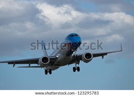 Passenger airplane few moments before landing - stock photo