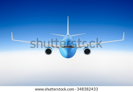 Passenger airplane flying in the blue sky among the clouds - stock photo