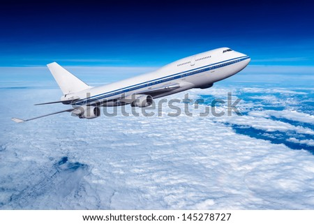 passenger airplane in the clouds. travel by air transport. flying to the top of the airliner. nobody - stock photo