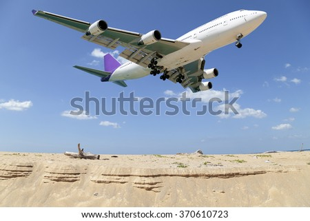 Passenger airplane landing , blue sky and sea background - stock photo