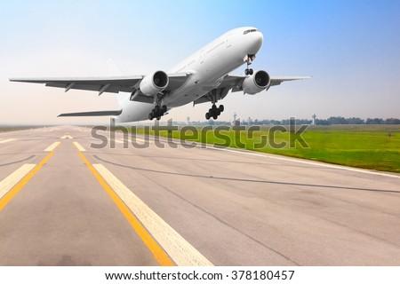 Passenger airplane landing on runway in airport - stock photo