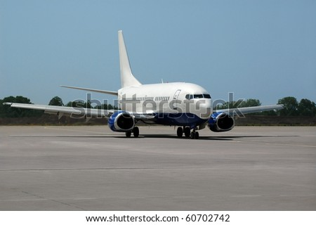 Passenger airplane move on runway - stock photo