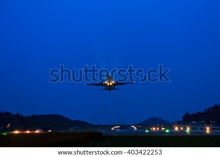 Passenger Airplane take off from runways at night - stock photo