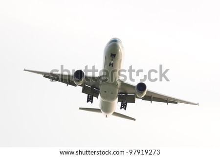 Passenger airplane view from bottom isolated over white background - stock photo
