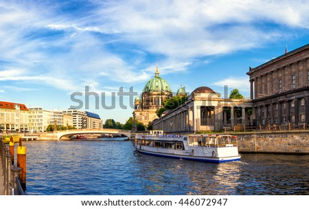 Passenger boat on River Spree goes towards Berlin Cathedral. This image is toned. - stock photo