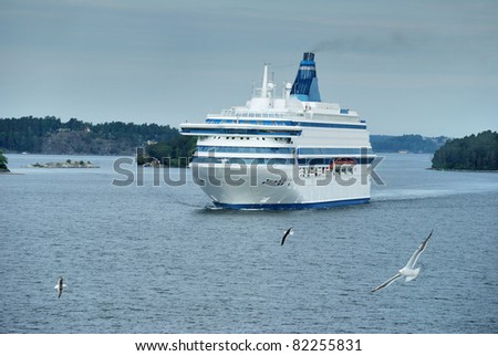 Passenger cruise ferry boat moves to port in Baltic. - stock photo