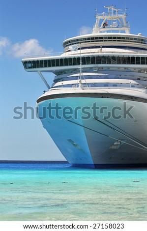 Passenger cruise ship anchored in the Caribbean waters - stock photo