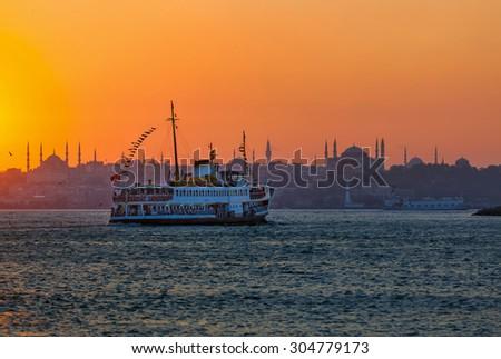 Passenger Ferry in the Bosphorus at sunset, Istanbul, Turkey - stock photo