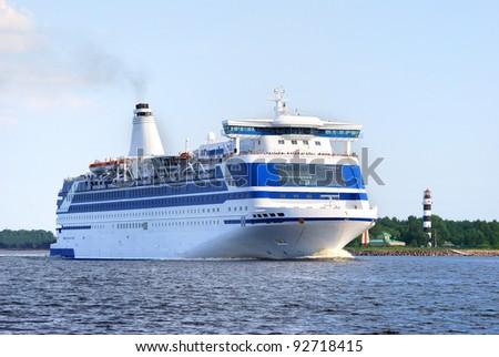 passenger ferry leaving port - stock photo