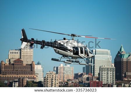 Passenger helicopter flying in New York City - stock photo