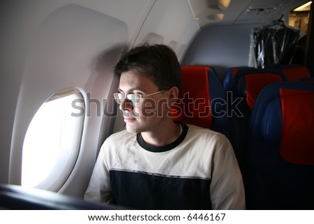 passenger in the aircraft - stock photo