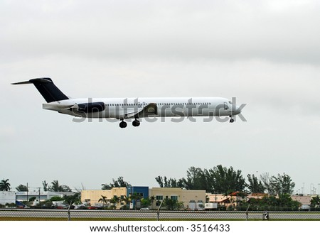 Passenger jet landing - stock photo