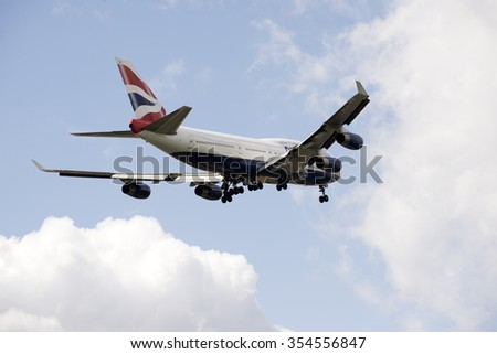 PASSENGER JET ON FINAL APPROACH TO LONDON HEATHROW AIRPORT UK - CIRCA 2015 - Boeing 747 jet preparing to land wheels down on final approach - stock photo