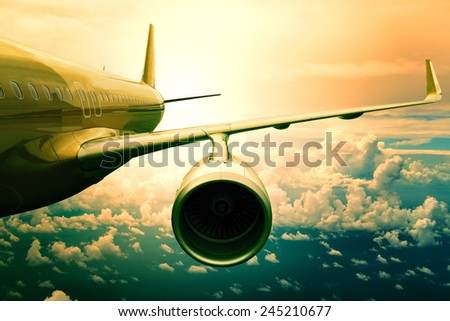 passenger jet plane flying  above cloud scape use for aircraft transportation and traveling business background - stock photo
