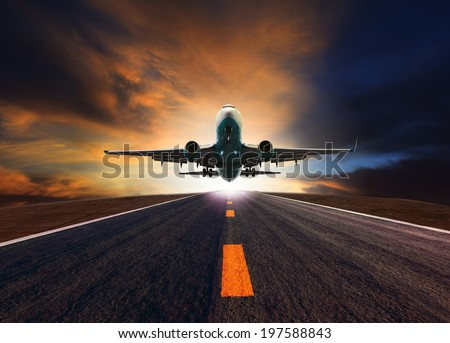 passenger jet plane flying over airport runway against beautiful dusky sky use for aircraft transport and cargo logistic and traveling business industry - stock photo