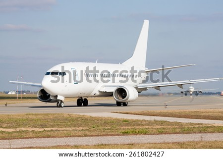 Passenger jets on the runway in the airport - stock photo