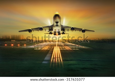passenger plane fly up over take-off runway, concept - stock photo