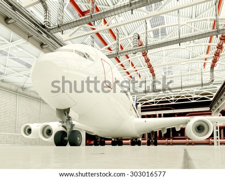 Passenger plane in the hangar. - stock photo