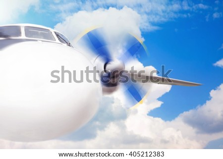 Passenger plane in the sky on the cloud background - stock photo