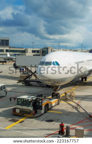 Passenger plane maintenance in airport before flight. - stock photo