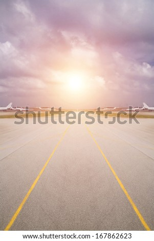 passenger plane preparing for take-off on the airport runway - stock photo