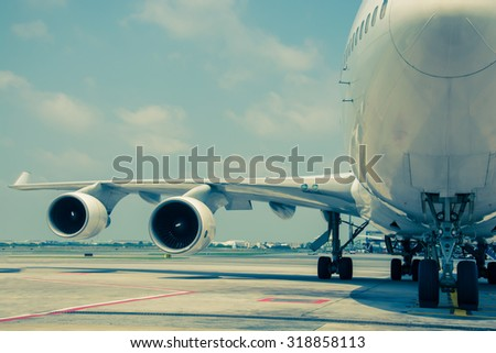 Passenger planes at the airport shoot on the bus, vintage color style - stock photo