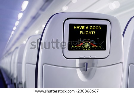 Passenger seat of plane with screen. Have a good flight! - stock photo