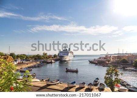 Passenger ship in the port of Nessebar - stock photo