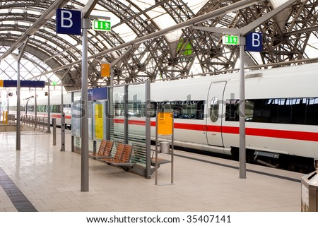 Passenger train at the railway station - stock photo