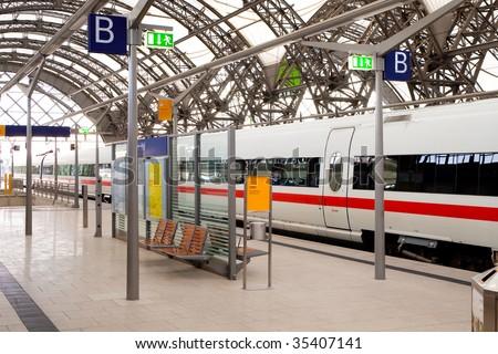 Passenger train at the railway station - stock photo