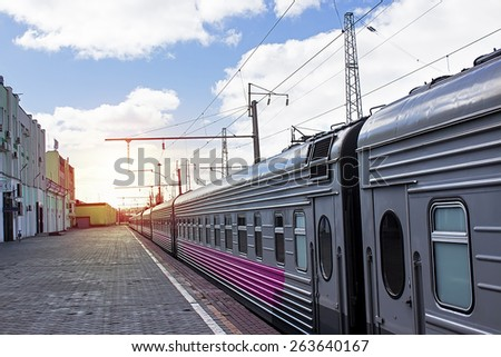 Passenger train at the station - stock photo