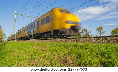 Passenger train moving at high speed - stock photo