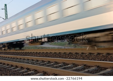 Passenger train passing by with motion blur - stock photo