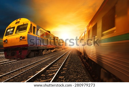 passenger trains and industry container  railroads running on railways track against beautiful sun set sky use for land transport and logistic business  - stock photo