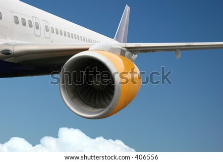 Passengerplane flying above the clouds (No logos on the plane) - stock photo