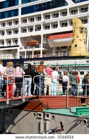 Passengers boarding on sea liner - stock photo