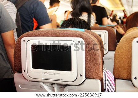 passengers in an airplane. selective Focus - stock photo