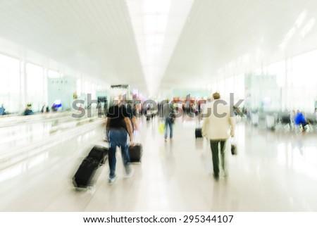 Passengers in Barcelona Airport - stock photo