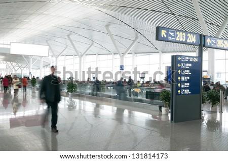 Passengers in Shanghai Pudong International Airport Airport - stock photo