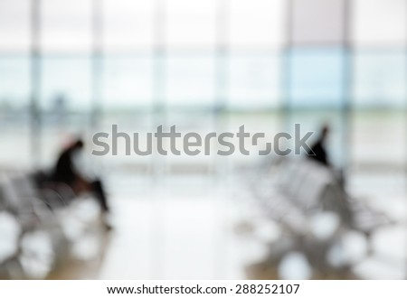 Passengers in the airport lounge - defocused blured background - stock photo